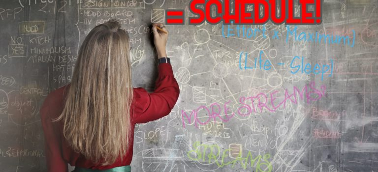 Woman writing on chalkboard, with the word SCHEDULE featured prominently